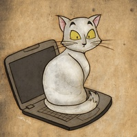 White cat on a computer